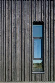 Black strips & windows close facade - 01