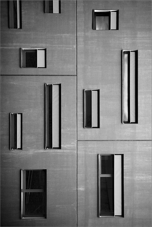 Grey metal elongated windows facade - 01