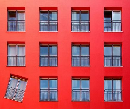 Red facade & one balcony asymetric