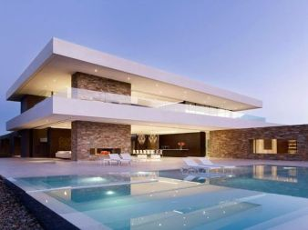 White concrete stone pool house