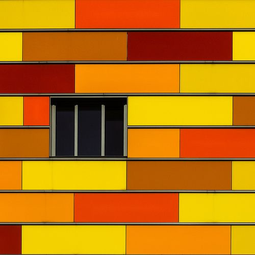 Yellow, brown, red panels facade