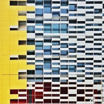 Yellow white balconies facade